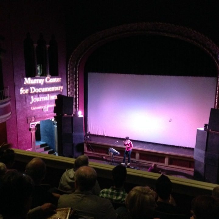 Syna So Pro busks before the first Midwest screening of 'Citizenfour'.